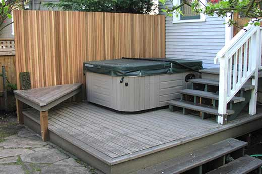 deck with new hot tub and privacy screen