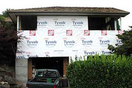 closeup of new master bedroom and garage under construction